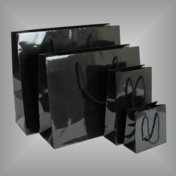 Schwarze Lacktaschen mit Kordeln, versch. Größen